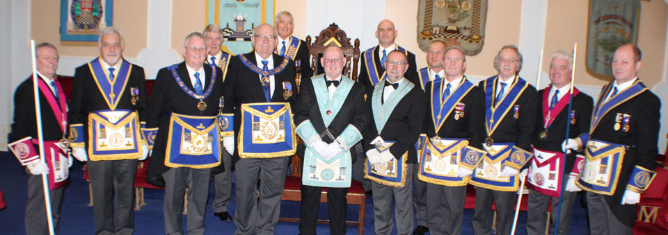 John (centre) surrounded by grand and Provincial grand officers.