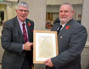 Receiving a copy of the 'Roll of Honour' from Gary Smith.