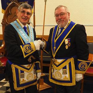 Bob Taylor (left) hands over to installing master Derek Lewthwaite.