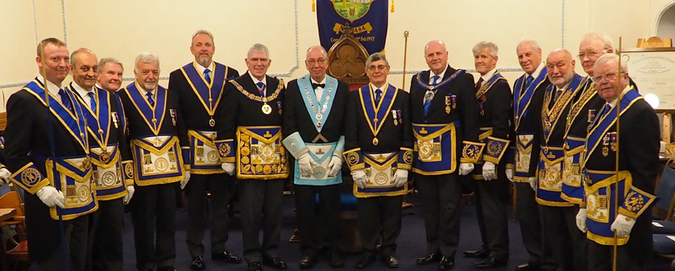 John Aplin and Tony Harrison surrounded by grand and acting Provincial grand officers.