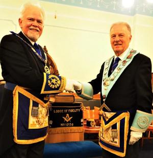 David Randerson (left) congratulates Geoff Fogden on attaining the master's chair.