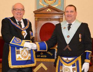 Philip Gunning (left) congratulating Darren Brown.