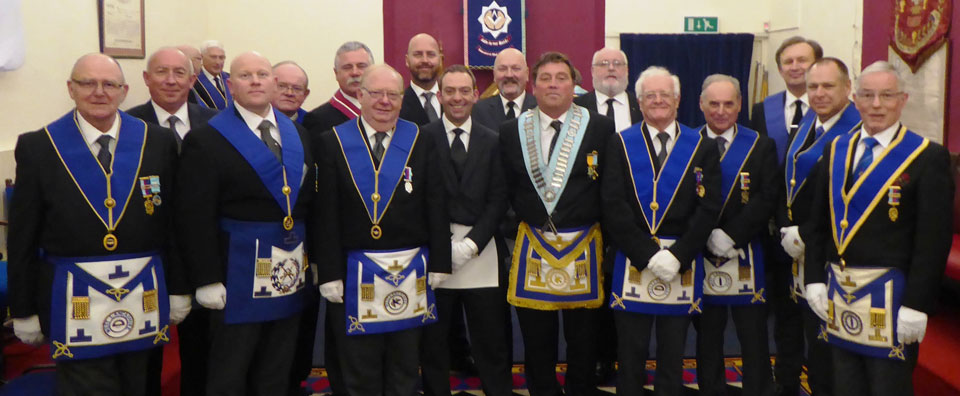 Gareth Furmston and Mark Ashlee (centre) surrounded by West Lancashire Masons.
