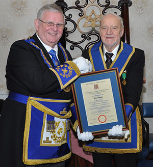 Stewart Seddon (left) presents Brian Bargh with a certificate of appreciation.