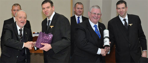 Pictured left: Brian Bargh receives a gift from Andrew Howarth with Ian Halsall in the background. Pictured right: Stewart Seddon receives a gift from Andrew Howarth with Ian Halsall in the background.