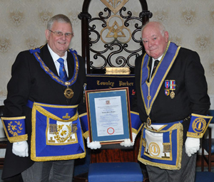 Stewart Seddon (left) presents a certificate of appreciation to Richard Higson.