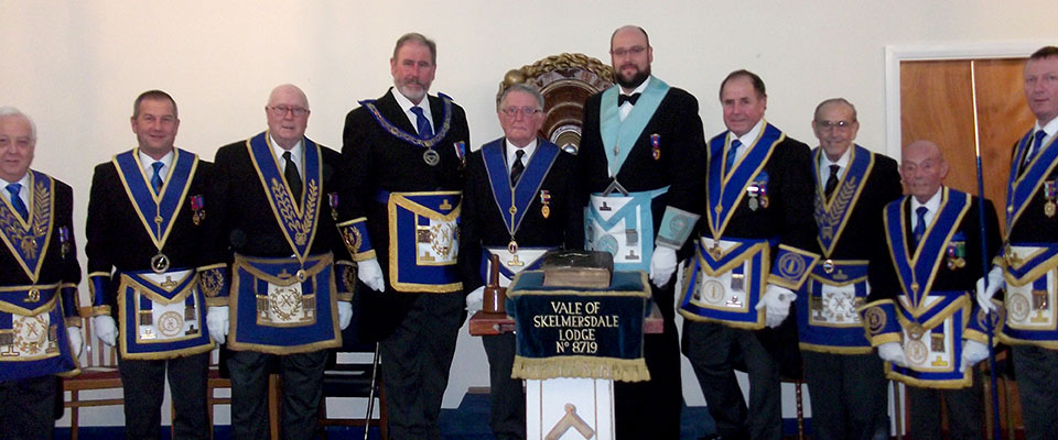 Frank Umbers and Bryan Collier (centre) with the grand officers and acting Provincial grand officers.