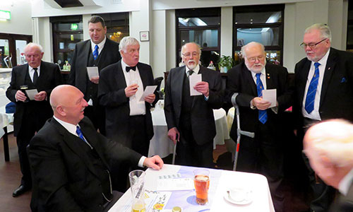 The brethren of the lodge singing the master's song.