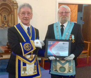 Malcolm Sandywell (left) presents John Rogers with the Vice-Patronage MCF 2021 Festival certificate.