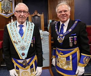Derek (right) congratulates David on returning to the chair of Halcyon Lodge for the third time.