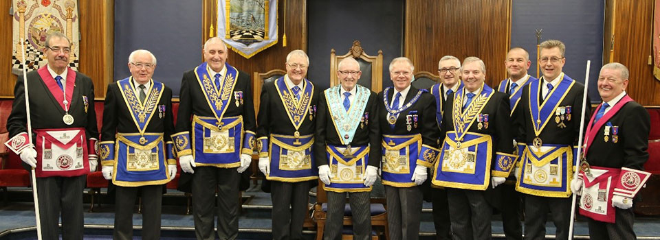 David Catterall (centre) with Derek Parkinson and other grand and acting Provincial grand officers.