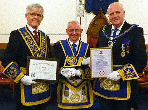 Pictured, from left to right, are: Ian Ward, Clive Gitsham and David Winder with the two 50th certificates presented during the meeting.