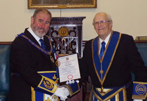 Brian Murphy (right) receiving his 50-year certificate from Frank Umbers.