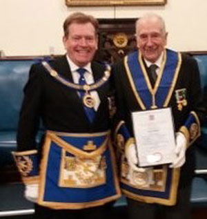 Kevin Poynton (left) presents the certificate to Cyril Gibbons