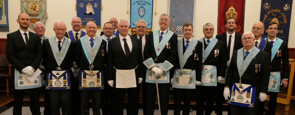 Anthony Hamilton being supported by officers of the lodge and guests after his initiation.