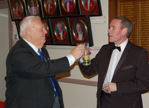 David Anderton (left) takes wine with Anthony Summers.
