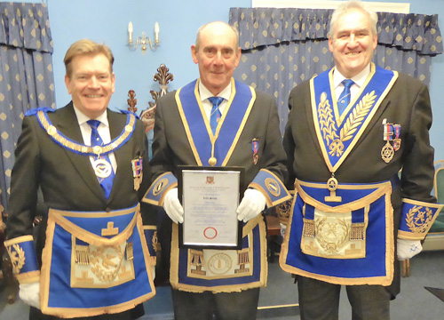 Pictured left to right, are: Kevin Poynton, John Smith with his certificate and Andrew Whittle.