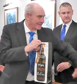 John Smith receives a gift from the lodge.