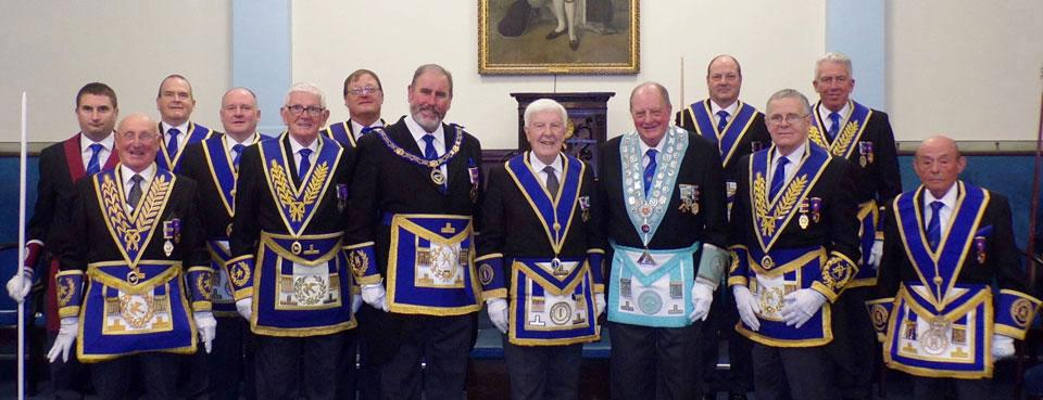 Gordon Hughes and the WM Ken Hornby (centre) with grand and Provincial grand officers.