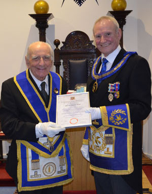 Dave (right) presents Bill with his 50-year certificate.