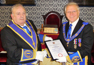 Ken Dobie (left) receives his jubilee certificate from Derek Parkinson