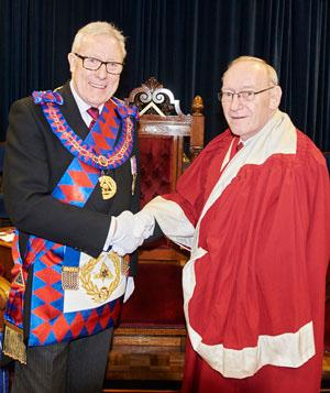 Ian Higham congratulates James Carmichael-Prince.