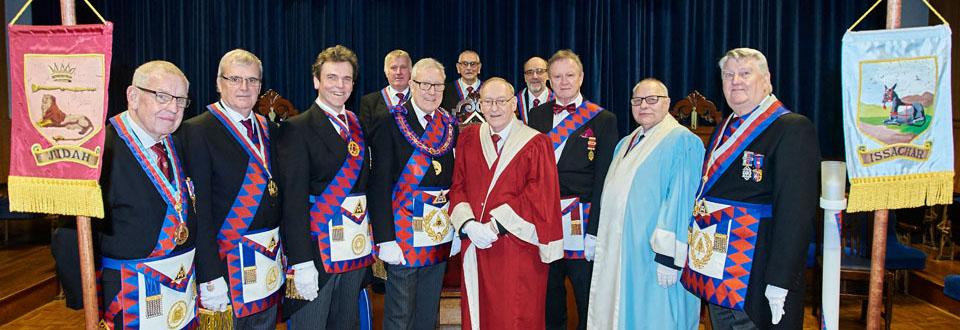 Ian Higham (Centre) with acting Provincial grand and grand officers congratulate James.