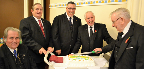Cutting the cake. Pictured from left to right, are: Dave Jones, Tom McLaughlin, Jorge Perez, Bernie Ashley and Stan Sutch
