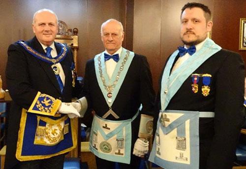 David Winder (left) congratulates Barrie Whiteside (centre) and Adam Simpson.