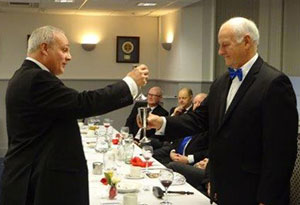 John Darrell (left) toasts the master during the master's song.