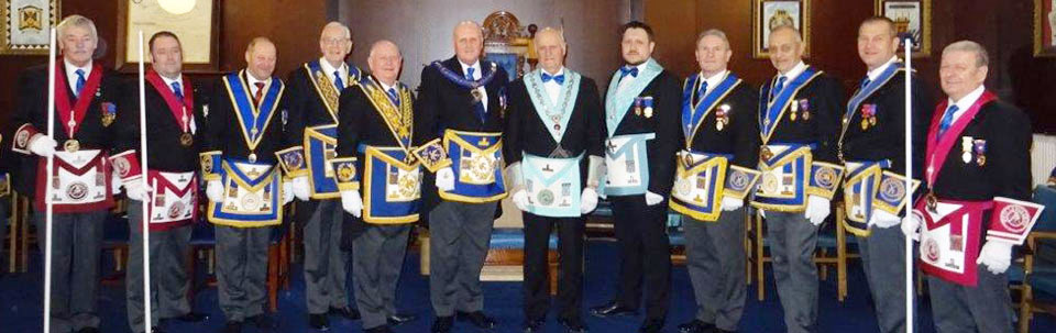 Pictured are: David Winder and Barrie Whiteside (centre) with distinguished grand and acting Provincial grand officers.