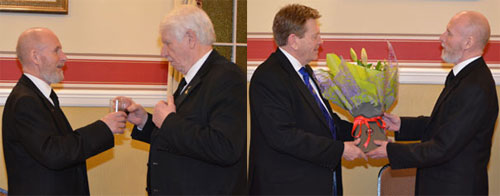 Pictured left: Chris Cullen (left) with Norman Pritchard singing the master's song. Pictured right: Kevin (left) receiving flowers from Chris.