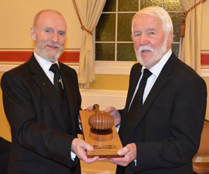 Chris (left) carefully handing over the 'Travelling Gavel' to Stuart Ainsworth WM Lodge of Charity.
