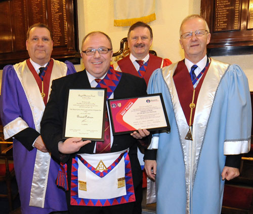 Graham Greenall (front row left), presenting the certificates to (left to right) Darren, Eric and Mike