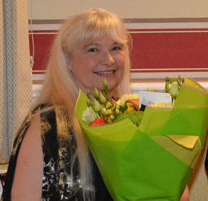 Caroline Crook with her bouquet of flowers.