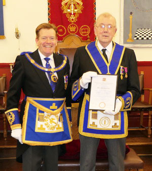 Brian Tilley (right) with his certificate, presented by Kevin Poynton.