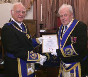 David Ogden (left) presents the celebratory certificate to Alan Slater.