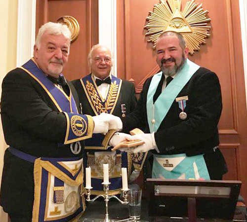 Barry Dickinson (left) presents an inscribed gavel, on behalf of the lodge, to the WM with David Ogden looking on.