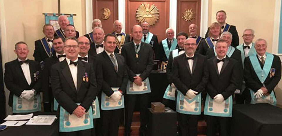 The intrepid travellers from Bryn in the grand lodge temple with officers from Kosmopolis Lodge.