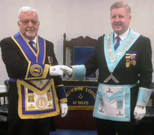 Barry Dickinson (left) congratulates Paul Joynson on attaining the chair of Prodesse Lodge.