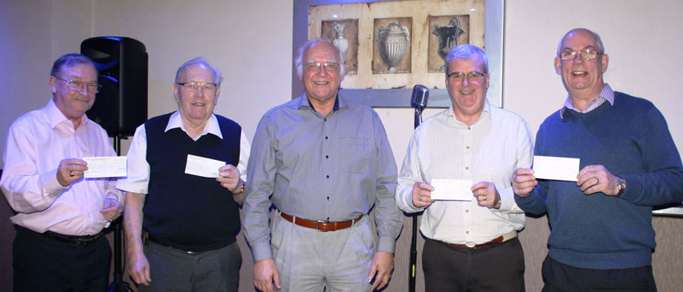 Dividing the proceeds. Pictured from left to right, are: Pete Kelly, Ernest Lloyd, David Ogden, John Selley and David Whitmore.