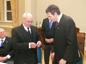 WM Andrew Howarth (right) presents Peter Dawson with a 50 years pin.