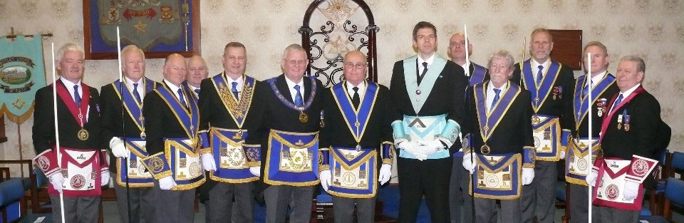 Peter Dawson (centre right) and Stewart Seddon (centre left) accompanied by grand and acting Provincial grand officers.