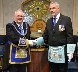 Stewart Seddon (left) congratulates Paul Spann (right).
