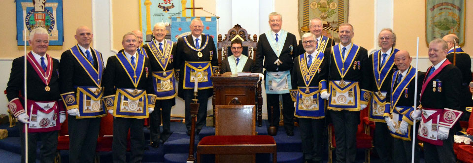 Peter Hainsworth accompanied by his principal guest Stewart Seddon, immediate past master, Bryan Hoarty and the other grand and acting Provincial grand Officers, plus group officers.
