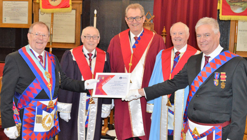 Pictured from left to right, at the presentation of the vice patron certificate, are: Colin Rowling, Brian Warrington, Ken Needham, Ray Griffiths and Simon Hanson (group charity steward).