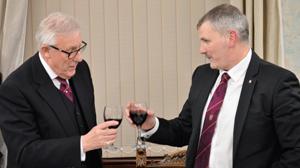 Ian Higham (left) toasting the first principal Craig Simpson.