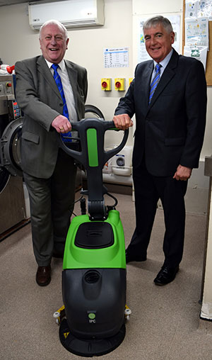 Jeff and Chris (right) look set to 'clean up' with the new floor cleaning equipment.