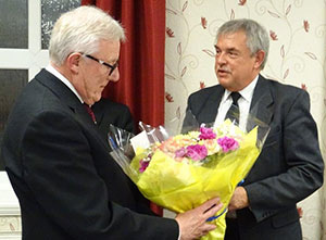 Ian Higham (left) receives flowers from Andrew Harrison.