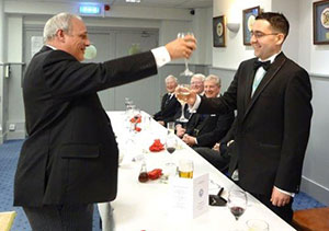 John Darrell (left) toasts Glen Brooks during the master's song.